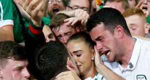 Robbie Brady celebrates with his girlfriend Kerrie Harris, his brother, and supporters after the UEFA Euro 2016 group E match against Italy at Stade Pierre Mauroy in Lille. Photograph: Laurent Dubrule/EPA