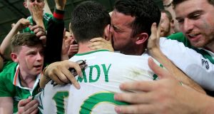Robbie Brady celebrates scoring Ireland's winning goal against Italy with his brother. Photograph: Inpho/Donall Farmer