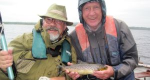 Derek Evans (Irish Times) with trout, and Maurice Neill (County Down Spectator) on Mask during media angling outing.