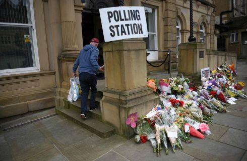 JO COX: People pass floral tributes to murdered MP Jo Cox outside Batley Town Hall as they arrive to vote in the EU referendum in Batley, northern England. Photograph: Oli Scarff/AFP/Getty Images