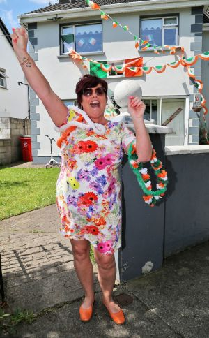 PROUD PARENT: Robbie Brady's mother, Maria, outside the family home in Baldoyle, after her son scored the winning  goal against Italy, which kept Ireland in the European Championship. Photograph: Colin Keegan/Collins Dublin.