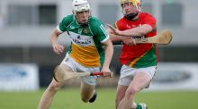 Carlow's Conor Foley with Ronan Hughes of Offaly during the Leinster under-21 hurling championship semi-final. Photo: Tommy Dickson/Inpho