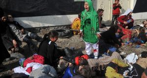 Massoud Hossaini's Pulitzer-winning image of a girl crying after a suicide bomber's attack in Kabul. Photograph:  Massoud Hossaini/AFP/Getty Images