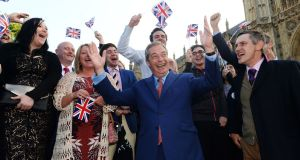 Ukip leader Nigel Farage greets his supporters on College Green in Westminster, London, after Britain voted to leave the European Union in an historic referendum which has thrown Westminster politics into disarray and sent the pound tumbling on the world markets. Photograph: Anthony Devlin/PA Wire