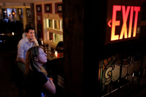 People gather around a television in The Churchill Tavern, a British themed bar, as the BBC announces that Britain has voted to leave the European Union, in the Manhattan borough of New York, U.S., June 24, 2016.  Photograph: Andrew Kelly / Reuters