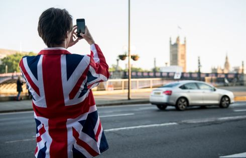 A vote LEAVE supporter takes a photo of Parliament from outside Vote Leave HQ, Westminster Tower on June 24, 2016 in London, England.  Photograph: Chris J Ratcliffe/Getty Images