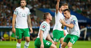 Republic of Ireland captain Séamus McCarthy commends team-mate James McCarthy during the victory over Italy at Stade Pierre Mauroy in Lille on Wednesday. photograph: Laurent Dubrule/EPA