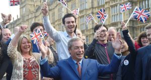 Nigel Farage, the leader of the United Kingdom Independence Party (UKIP), celebrates the  vote to leave the European Union in London. Photograph: Toby Melville/Reuters