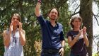 Pablo Iglesias, leader of the left-wing party Podemos, gestures towards supporters at a meeting ahead of tomorrow's elections. Photograph: Pablo Blazquez Dominguez/Getty Images
