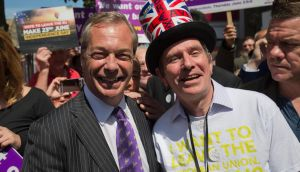 UK Independence Party (UKIP) leader Nigel Farage (left) posing for a photograph with a supporter in Clacton-on-Sea, south east England, while on the referendum  campaign trail. Photograph: Justin Tallis/Getty Images