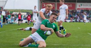 Shane Daly scores Ireland's second try during the World Rugby Under-20 Championship Final against England at the  AJ Bell Stadium in Salford, Manchester. Photograph:  Ryan Byrne/Inpho