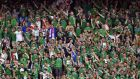 Northern Ireland fans cheer during the Euro 2016 round of sixteen football match Wales vs Northern Ireland at the Parc des Princes stadium in Paris. Photo: Getty Images