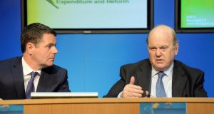 Minister for Public Expenditure and Reform Paschal Donohoe (left) and Minister for Finance Michael Noonan, at the publication of the Summer Economic Statement for 2016, at Government Buildings, Dublin. Photograph: Eric Luke/The Irish Times