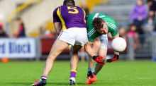 Aidan Breen of Fermanagh is tackled by Wexford's Brian Malone. Photo: Ken Sutton/Inpho
