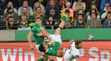 Ireland fullback Tiernan O'Halloran gets upended by Willie le Roux of South Africa during the Test match at Nelson Mandela Bay Stadium on Saturday. Photograph: EPA.