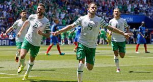 Robbie Brady celebrates after scoring a very early penalty for Ireland at the Stade de Lyon. Photograph: Reuters/Robert Pratta