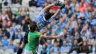 Dublin's Bernard Brogan catches a ball over the head of Meath's Mickey Burke. Photograph: Morgan Treacy/Inpho
