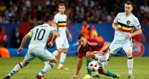 Hungary's Adam Szalai looks on as Belgium's Eden Hazard starts another attack. Photograph: Michael Dalder Livepic/Reuters