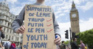 A young protestor holds a placard to demonstrate against the EU referendum result outside the Houses of Parliament in London. Photograph: Jason Alden/Bloomberg