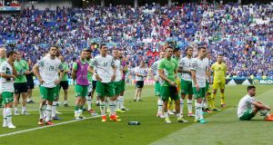 Dejected Ireland players after the 2-1 Euro 2016 loss to France at the Stade de Lyon. Potograph: Robert Pratta/Reuters