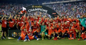 Chile celebrate after beating Argentina to win the 2016 Copa America title. Photo: Jason Szenes/EPA