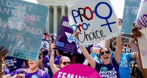 Pro-choice supporters celebrate outside the US supreme court after it struck down the requirement of doctors to have admitting privileges at local hospitals, among other restrictions. Photograph: Michael Reynolds/EPA