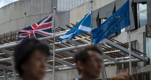 The  Scottish Saltire (centre), a Union Jack flag (left) and a European Union  flag  in front of the Scottish Parliament building in Edinburgh, Scotland on June 27th, 2016. The Brexit vote has thrown the relationship between the three political entities into turmoil. Photograph: Oli Scarff/AFP/Getty Images