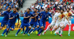 Italy and Spain players in action.  Photo:  Christian Hartmann/Reuters