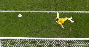 Spain's goalkeeper David De Gea tips a shot over the bar. Photo: John Sibley/Reuters
