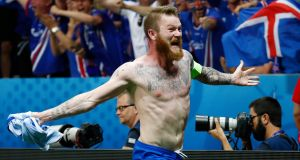 Iceland's Aron Gunnarsson celebrates after the game. Photo: Michael Dalder/Reuters