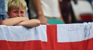 A young England fan reacts to his side's infamous 2-1 loss to Iceland in Nice. Photograph: Afp