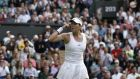 Spain's Garbine Muguruza celebrates beating Italy's Camila Giorgi in their women's singles first round match on the first day of the 2016 Wimbledon Championships. Photo: Getty Images