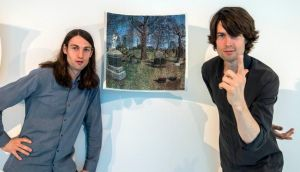 Oakes twins Trevor and Ryan with an ink drawing on concave paper at their exhibition in the Science Gallery in Dublin. Photograph: Brenda Fitzsimons