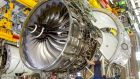 Working on a Rolls-Royce  engine:  the company reaffirmed its commitment to the UK in the wake of the decision to exit the European Union, but warned that longer term assurances would depend on a post-Brexit deal. Photograph: Gary Marshall/Rolls-Royce/PA Wire