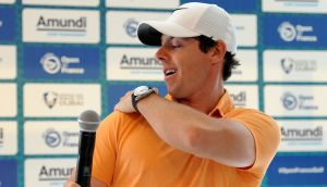 Rory McIlroy brushes away an insect at a press conference ahead of the 100th Open de France at Le Golf National in Paris. Photograph: Richard Martin-Roberts/Getty Images