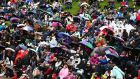 Supporters brave the elements during day three at Wimbledon. Photograph:    Jordan Mansfield/Getty Images