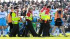 Glasgow's Finn Russell leaves the field injured last May. Photograph: James Crombie/Inpho