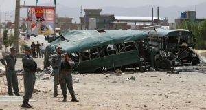 Afghan security forces inspect the damage on buses hit by suicide bombers at the site of an attack on the western outskirts of Kabul, Afghanistan on Thursday. Photograph: Omar Sobhani/Reuters
