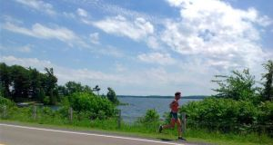 Michael Collins running along the Thousand Islands Parkway, Ontario.