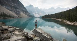 A woman overlooking Moraine Lake in Alberta, Canada. Photograph: Jordan Siemens