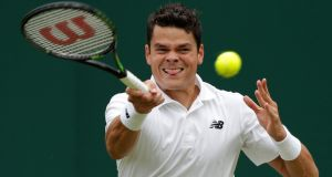 Canada's Milos Raonic returns against Italy's Andreas Seppi during their men's singles second round match. Photo: Getty Images