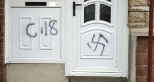 Racist graffiti daubed on the door of a house in the Orangefield area of Co Armagh. Photograph: PSNI Armagh/PA Wire