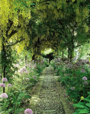 This laburnum and wisteria tunnel set around a riverstone path was created for Barnsley House by Rosemary Veney, one of the great landscapers celebrated in Women Garden Designers: 1900 to the Present, published by Garden Art Press. The 17th-century Cotswold stone country house and its acclaimed landscaped gardens, redesigned by Veney in the 1950s and now a chic boutique hotel, includes knot gardens and statues by Simon Verity, and is considered among England's most famous settings. Antiquecollectorsclub.com; barnsleyhouse.com