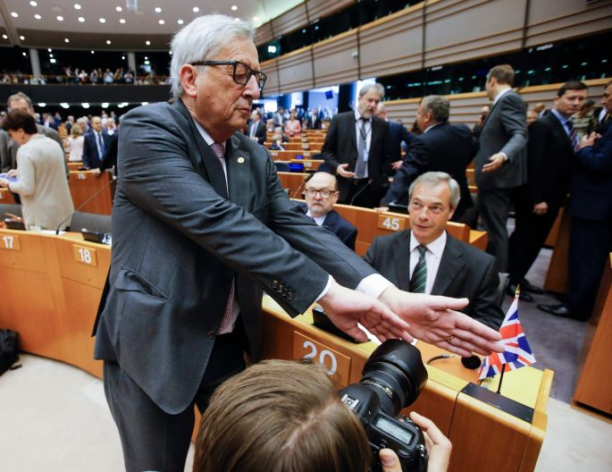 WEDNESDAY: European Commission president Jean-Claude Juncker tries to block a photographer's view of Nigel Farage, leader of the United Kingdom Independence Party, prior to the start of a plenary session of the European Parliament, in Brussels, Belgium. Photograph: Olivier Hoslet/EPA