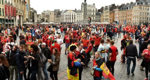 Wales and Belgium fans soak up the atmosphere in Lille prior to the quarter-final match  at the Stade Pierre Mauroy. Photograph:Joe Giddens/PA Wire