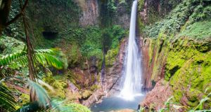 The Catarata del Toro waterfall falling into a volcano crater