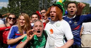 Fans at the end of the France v Republic of Ireland Euro 2016  match: Irish fans, from  North and South, will be awarded the Medal of the City of Paris for their behaviour. Photograph: Jacky Naegelen/Reuters