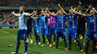 Iceland's players celebrate their team's win with supporters after the victory over England. Photograph: Getty Images