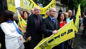 ASTI president-elect Ed Byrne and general secretary Kieran Christie with union members protesting outside the Dáil yesterday. Photograph: Cyril Byrne/The Irish Times