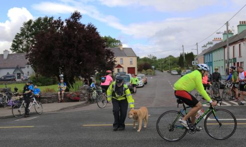 Jay-walking Dog assisted by An Gardai to cross the road as The Ring of Kerry Charity Cycle passed through Sneem Village over the weekend.  Photograph: Nick Bradshaw